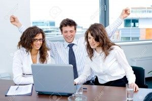 3884394-Happy-successful-business-people-sitting-on-meeting-at-office-working-on-laptop-computer-smiling--Stock-Photo